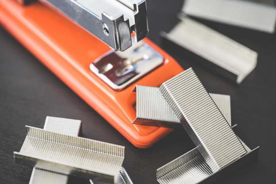 Red Stapler with Staples - What Not To Do In A Job Interview Cover Image